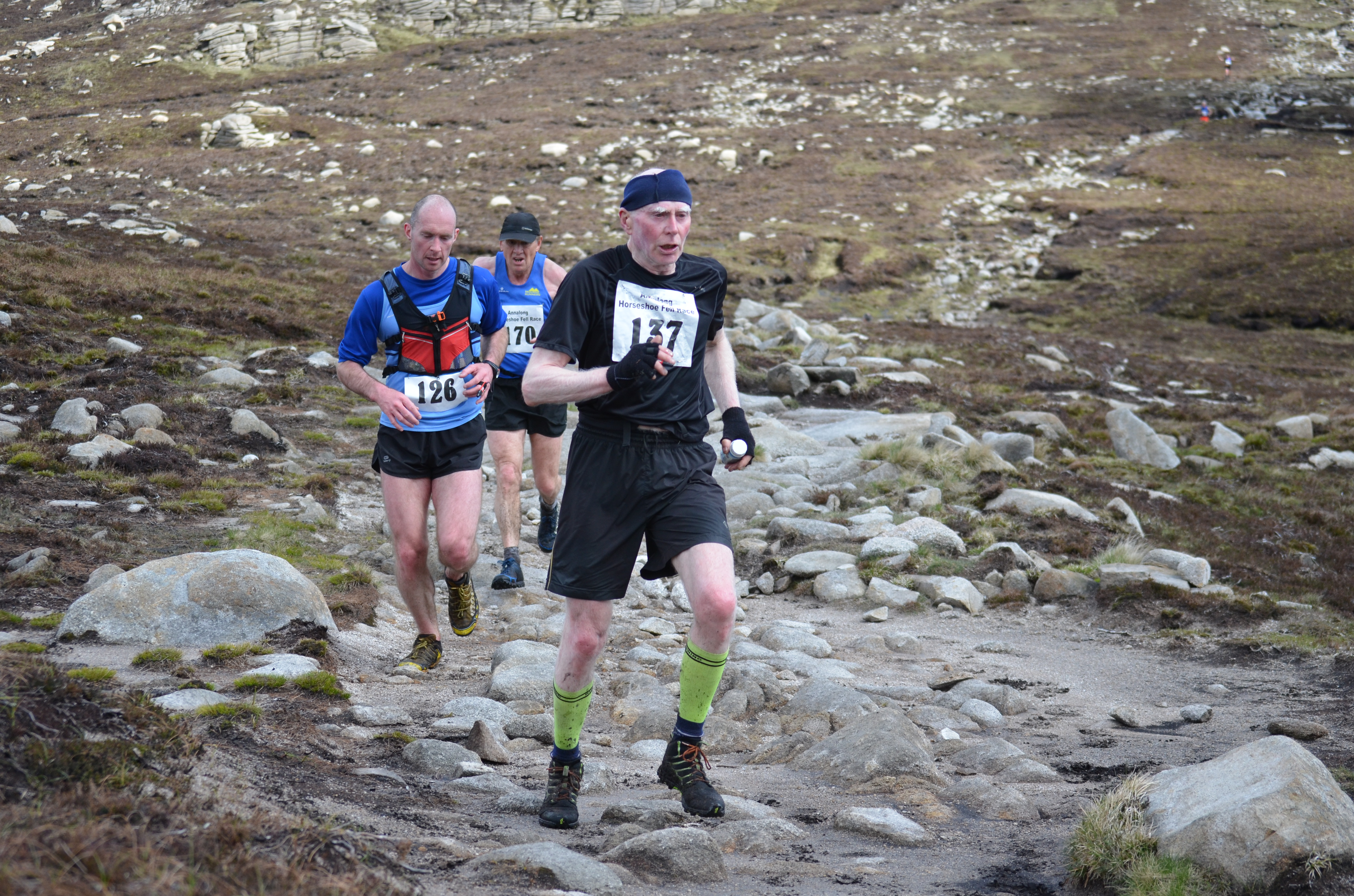 The race for first vet hots up with Jim Patterson (front) beating Stewart Cunningham (back)